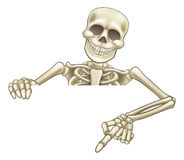 Cartoon Peeking Skeleton Sign. A skeleton Halloween cartoon character peeking over a sign and pointing at it Stock Photos