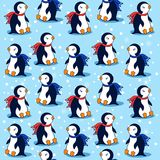 Cartoon penguin on blue background with snowflakes, vector seamless pattern, decorative texture, cheerful wallpaper Royalty Free Stock Photography