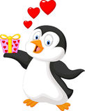 Cartoon penguin holding gift Stock Images