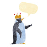 Cartoon penguin wearing crown with speech bubble Royalty Free Stock Images