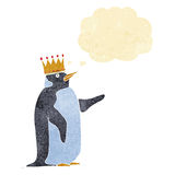 Cartoon penguin wearing crown with thought bubble Royalty Free Stock Photography