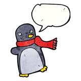 Cartoon penguin wearing scarf Royalty Free Stock Photo