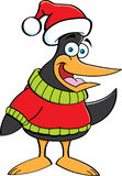 Cartoon penguin wearing a sweater and a Santa hat. Royalty Free Stock Photo