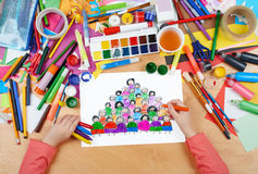 Cartoon people team collection group portrait child drawing , top view hands with pencil painting picture on paper, artwork workpl Stock Images