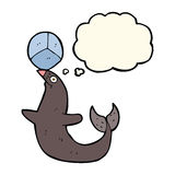 Cartoon performing seal with thought bubble Stock Photo
