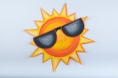 Cartoon picture of sun in black glasses drawn with gouache lay on white background Stock Images