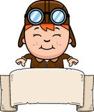 Cartoon Pilot Banner. A cartoon illustration of a child pilot with a banner Stock Image