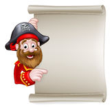 Cartoon Pirate Pointing at Scroll Sign. Cartoon pirate peeking around pointing at a scroll sign Royalty Free Stock Images