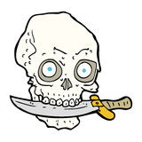 Cartoon pirate skull with knife in teeth Royalty Free Stock Photo
