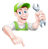 Cartoon Plumber or Mechanic Pointing Stock Image