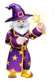 Cartoon Pointing Wizard. A cartoon Halloween wizard character pointing and waving a magic wand Royalty Free Stock Image