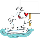 Cartoon polar bear holding a sign. Royalty Free Stock Photography