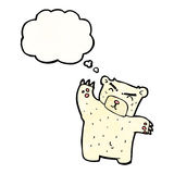 Cartoon polar bear with thought bubble Stock Image