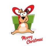 Cartoon portrait of funny smiling dog in santa hat with big gift box  Royalty Free Stock Photo