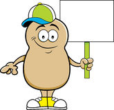 Cartoon potato holding a sign. Royalty Free Stock Photo