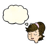 Cartoon pretty female face with thought bubble Stock Photos