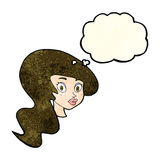 Cartoon pretty female face with thought bubble Stock Photography
