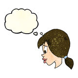 Cartoon pretty female face with thought bubble Stock Photo