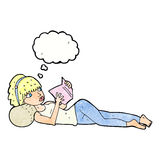 Cartoon pretty woman reading book with thought bubble Royalty Free Stock Photo