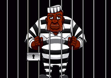 Cartoon prisoner behind bars in the prison Stock Photography