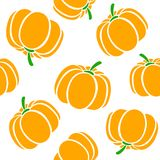 Cartoon pumpkins on a white background. Simple vector background Cute autumn pattern Seamless textile. design for greeting card an. D invitation of seasonal fall Royalty Free Stock Photo