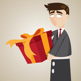 Cartoon puppet businessman holding gift box Royalty Free Stock Photo