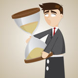 Cartoon puppet businessman holding sandglass Royalty Free Stock Photo