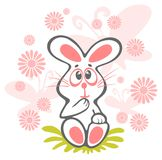 Cartoon rabbit. Cheerful rabbit and flowers isolated on a white background Stock Photo