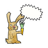 Cartoon rabbit with carrot with speech bubble Royalty Free Stock Image