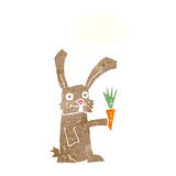 Cartoon rabbit with carrot with thought bubble Stock Images