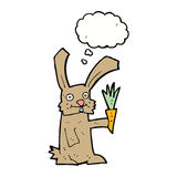 Cartoon rabbit with carrot with thought bubble Royalty Free Stock Images