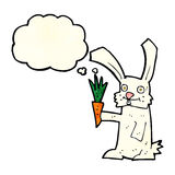 Cartoon rabbit with carrot with thought bubble Stock Image
