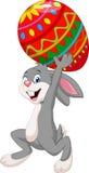 Cartoon rabbit carrying Easter egg. Illustration of Cartoon rabbit carrying Easter egg Royalty Free Stock Photos