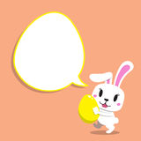Cartoon rabbit carrying easter egg with speech bubble. For design Royalty Free Stock Photography