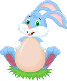 Cartoon rabbit with egg Royalty Free Stock Photography