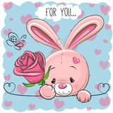 Cartoon Rabbit with flower. On a blue background stock illustration