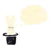 Cartoon rabbit in hat trick Royalty Free Stock Photo