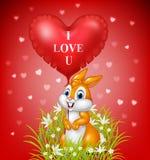 Cartoon rabbit holding red heart balloon Royalty Free Stock Photos