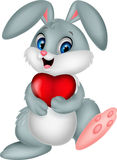 Cartoon rabbit holding red heart. Illustration of Cartoon rabbit holding red heart Stock Photography