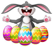 Cartoon rabbit laughing with five decorated easter eggs Royalty Free Stock Image