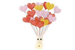 Cartoon rabbit with love letters, hanging on many  heart balloon Stock Photos