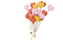 Cartoon rabbit with love letters, hanging on many  heart balloon Stock Images