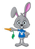 Cartoon Rabbit - Pointing With Carrot Royalty Free Stock Photography