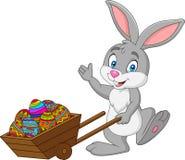 Cartoon rabbit pushing cart full of Easter eggs. Illustration of Cartoon rabbit pushing cart full of Easter eggs royalty free illustration