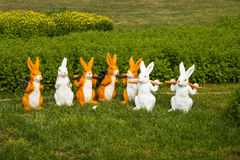 Cartoon rabbits. On the grass,  a group of lovely cartoon rabbits Royalty Free Stock Photo