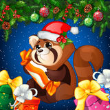 Cartoon raccoon in Christmas hat with gift on a Christmas background Stock Photos