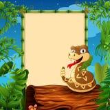 Cartoon rattlesnake on hollow log near the empty framed signboard Stock Photos