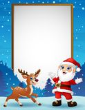 Cartoon reindeer and santa claus with blank board Royalty Free Stock Image