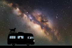 Cartoon retro car on road at night. Vector illustration with silhouettes of people and dog traveling in camper. Family road trip. Space dark background with vector illustration