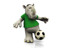 Cartoon rhino kicking soccer ball. Royalty Free Stock Images